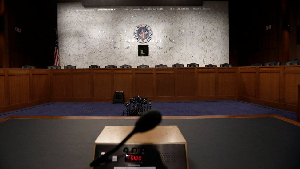 The witness table where former FBI Director James Comey will sit faces a panel of empty chairs