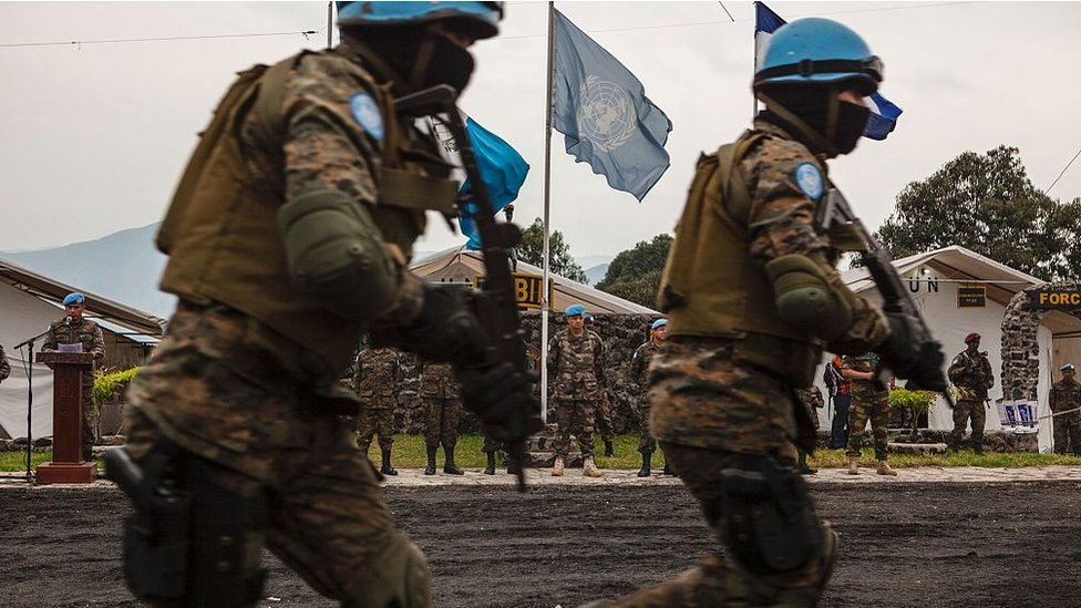 Major General Jean Baillaud (C), deputy head of the UN Mission in the Democratic Republic of Congo (MONUSCO), visits the Guatemalan military base in Sake on July 12, 2016 as members of the Guatemalan Special Forces 'Kaibil', stationed in the Democratic Republic of the Congo as part of the MONUSCO peacekeeping force, take part in a drill