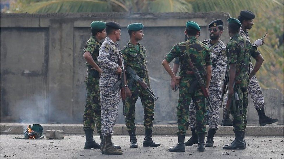 Special Task Force Bomb Squad officers inspect the site of an exploded van near a church that was attacked yesterday in Colombo, Sri Lanka April 22, 2019
