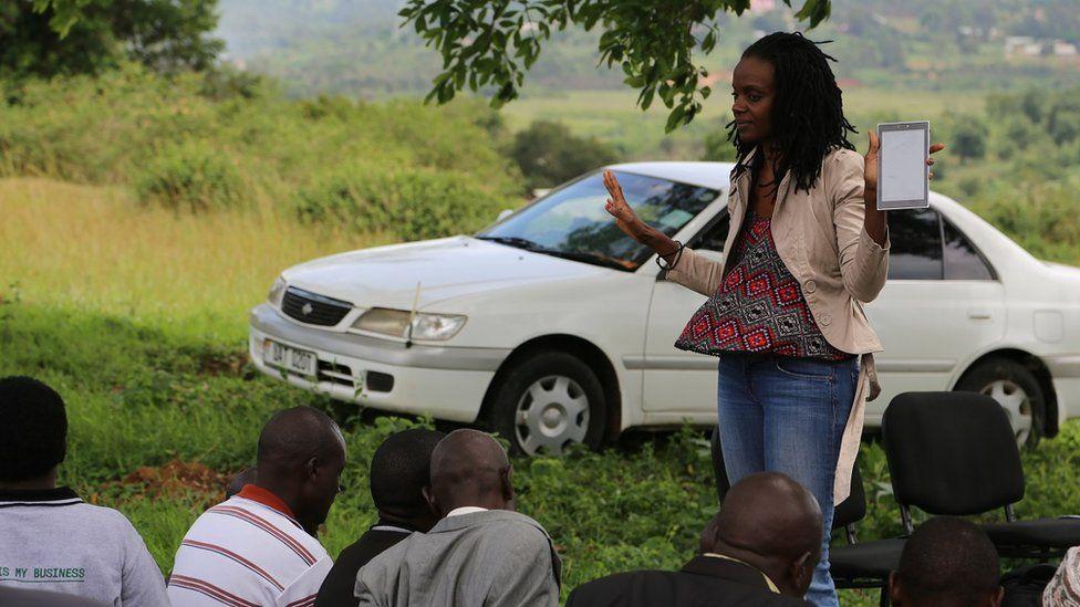 Catherine Nakalembe talking to a group of men