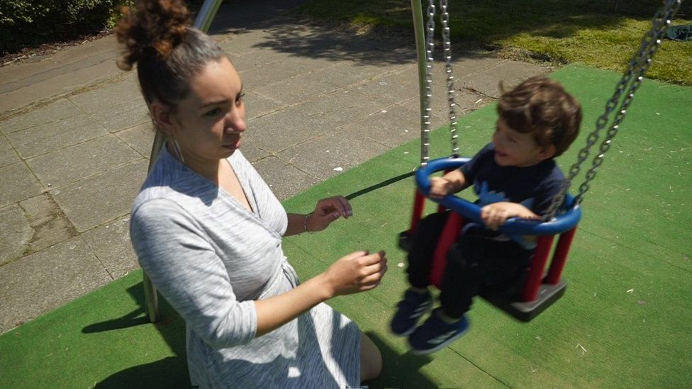 Jade Thomas and child on swing