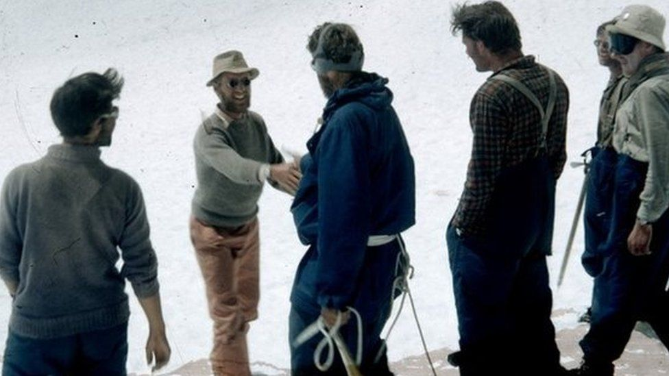 Morris (second from left) greets Sir Edmund Hillary on his return from the summit of Everest