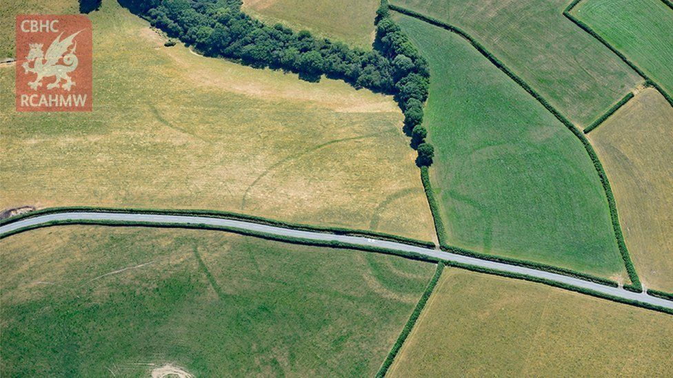 Iron Age farmstead Whitland seen with a modern road running through it