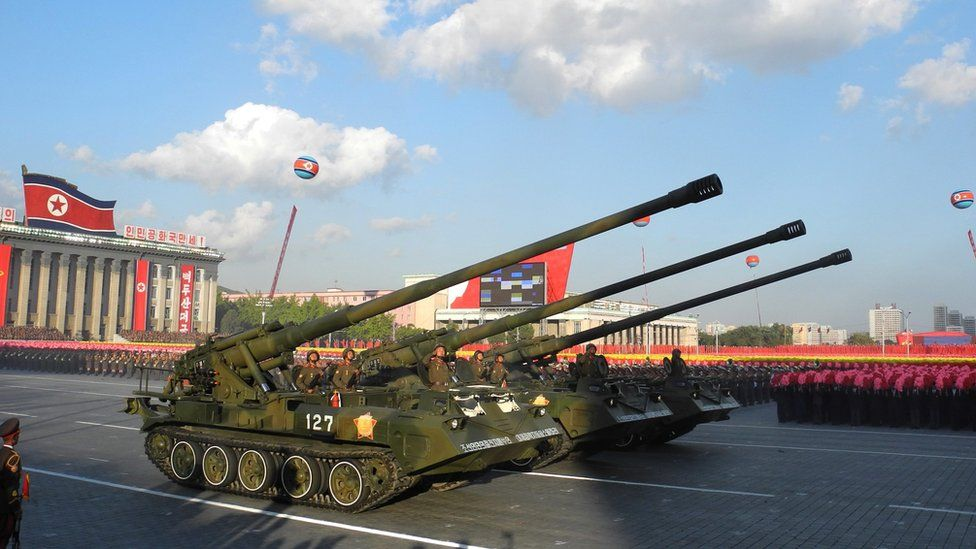 Soldiers drive heavy military equipment during the military parade for the 70th anniversary of the founding Workers' Party, Pyongyang, North Korea - Saturday 10 October 2015