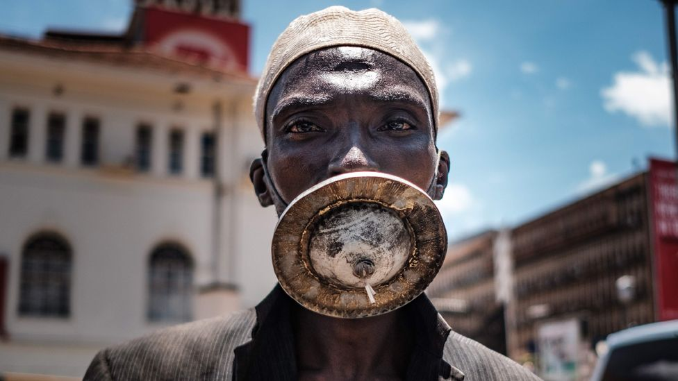A man wearing what looks like a metal-disc as a mask in Kampala, Uganda - Wednesday 1 April 2020