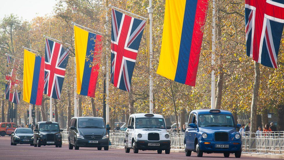 Flags of the UK and Colombia flying on the Mall, London, ahead of the state visit the Colombian president Juan Manuel Santos