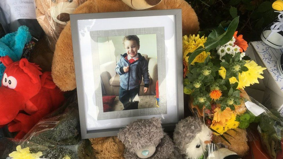 Toys, photograph and floral tributes