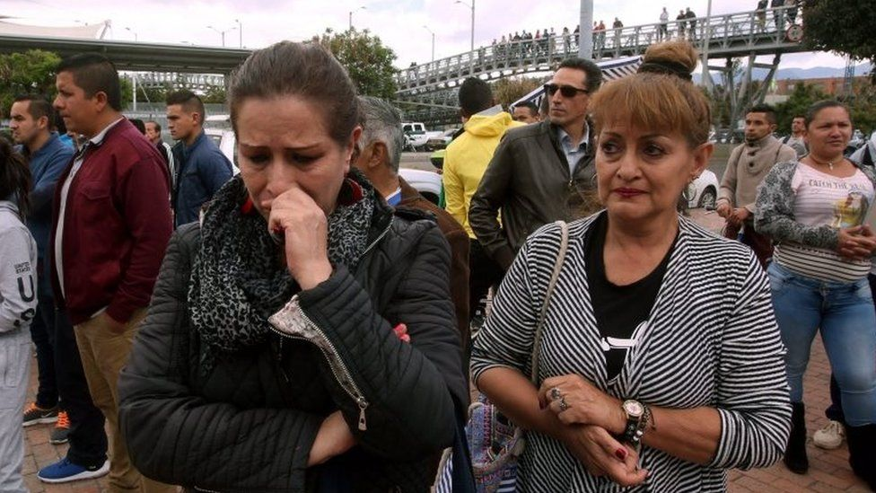 People wait for information about their relatives at the place where a bomb car cause an explosion at the Escuela General Santander de la Policia (Santander General Police School) in Bogota, Colombia, 17 January 2019
