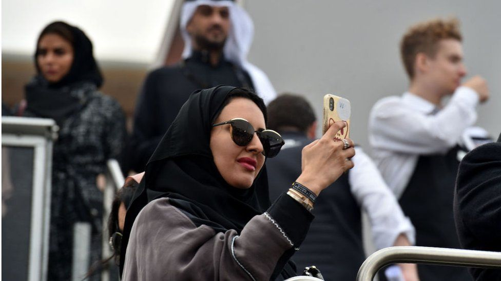 Saudi woman taking a photo