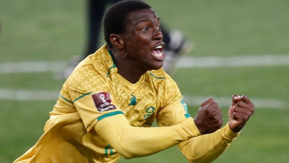 Bongokuhle Hlongwane celebrates after scoring his team's first goal during the FIFA World Cup Qatar 2022 qualifying round Group G football match between South Africa and Ghana at the FNB Stadium in Johannesburg on September 6, 2021.