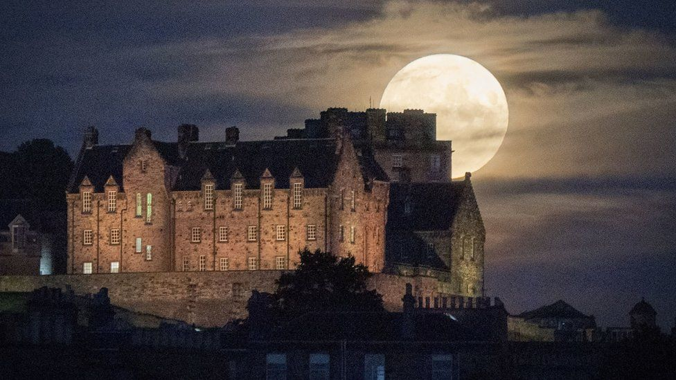 The July full moon, otherwise known as the Thunder Moon, above Edinburgh Castle.