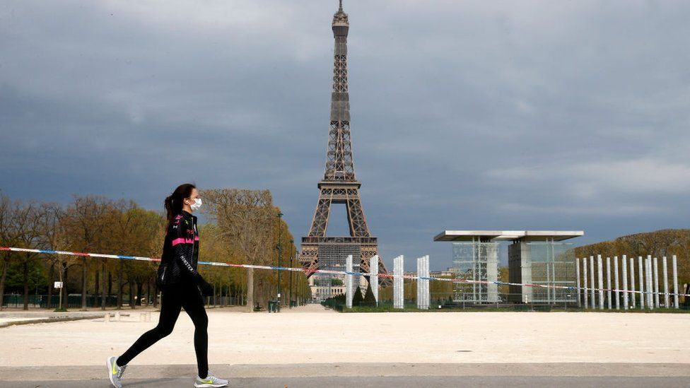 Jogger by the Eiffel Tower, Paris