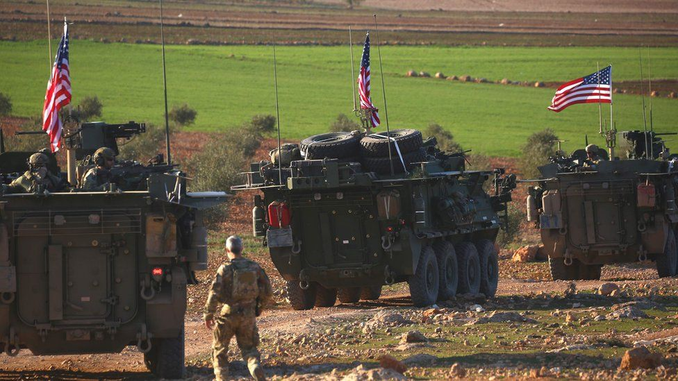 A convoy of US armoured vehicles drives near the village of Yalanli, on the western outskirts of the northern Syrian city of Manbij. March 5, 2017