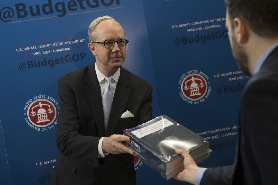 Republican congressmen distribute the White House budget proposal