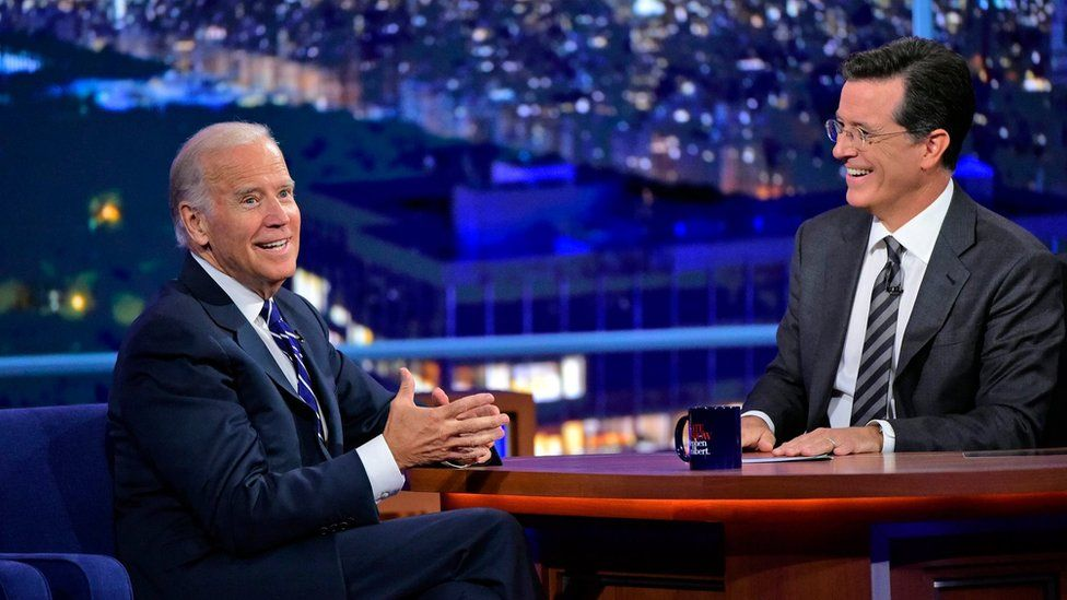 """Host Stephen Colbert, right, smiles as he talks with Vice President Joe Biden during a taping of """"The Late Show with Stephen Colbert,"""" on 10 September 2015"""