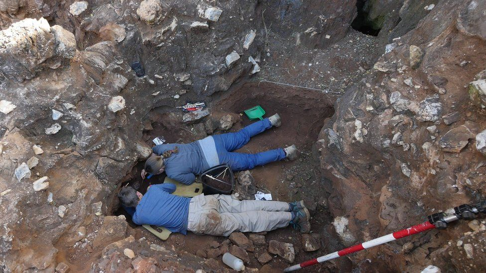 Two people dig in Drimolen quarry near Johannesburg