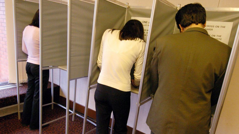 Voters in a polling booth
