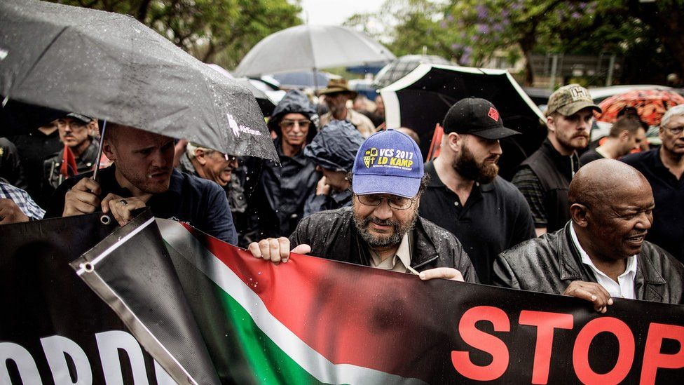South African opposition party Congress of the People (COPE) leader Mosiuoa Lekota (R) and members of the South African civil society organisation AfriForum and other civil organisations march to the Union Buildings to raise awareness on farm attacks on November 25, 2017 in Pretoria