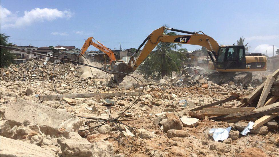 Digger at the site of demolitions in Dar es Salaam, Tanzania