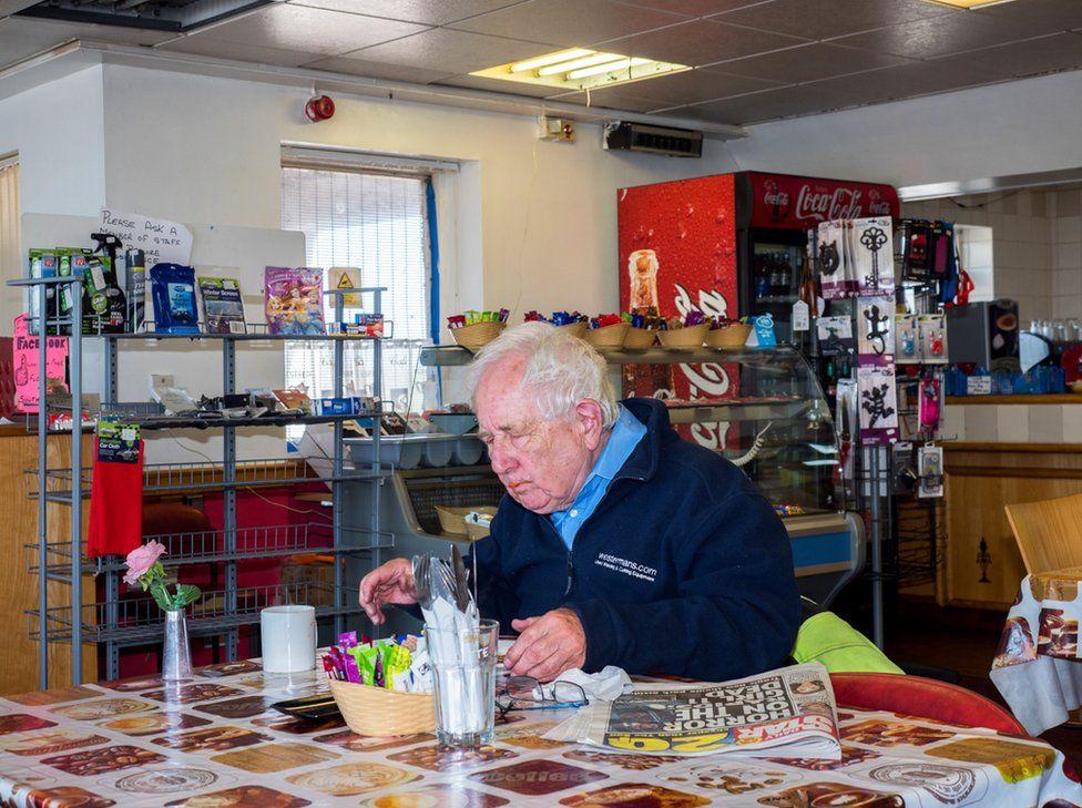 A man eats a Flo's cafe