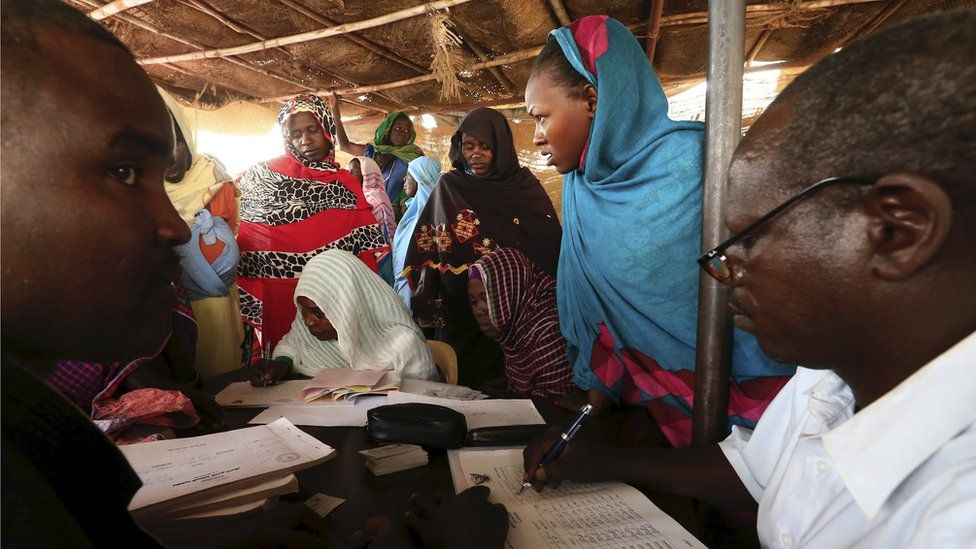 People register for a Darfur referendum, on whether to remain as five states or merge into one, at a registration centre at Abo-Shouk IDPs camp at Al Fashir in North Darfur February 17, 2016.