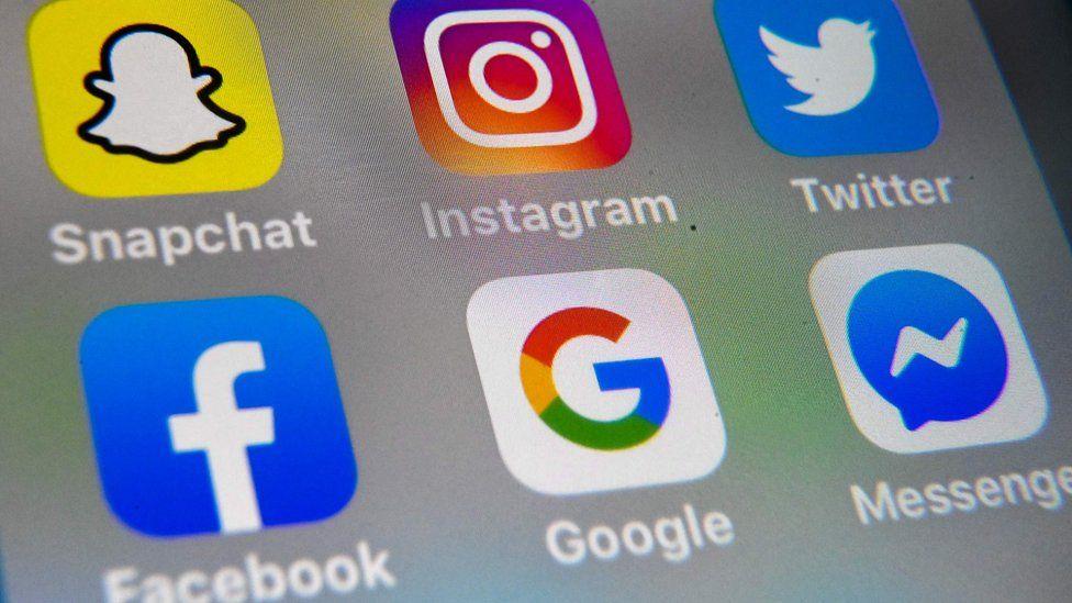 photo taken taken on October 1, 2019 in Lille shows the logo of mobile app Instagram, Snapchat, Twitter, Facebook