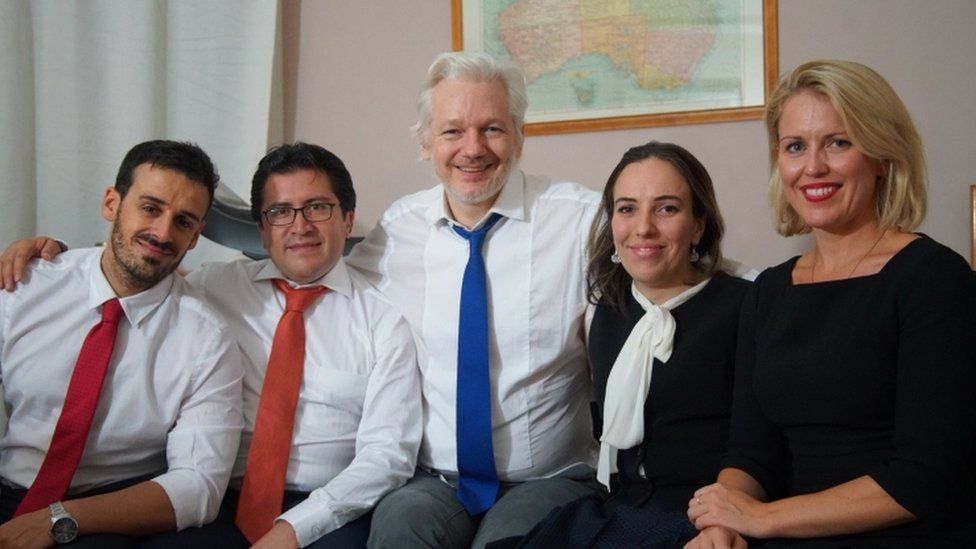 An undated photo issued by Wikileaks shows Julian Assange with his partner Stella Morris (to his left) alongside other members of his legal team