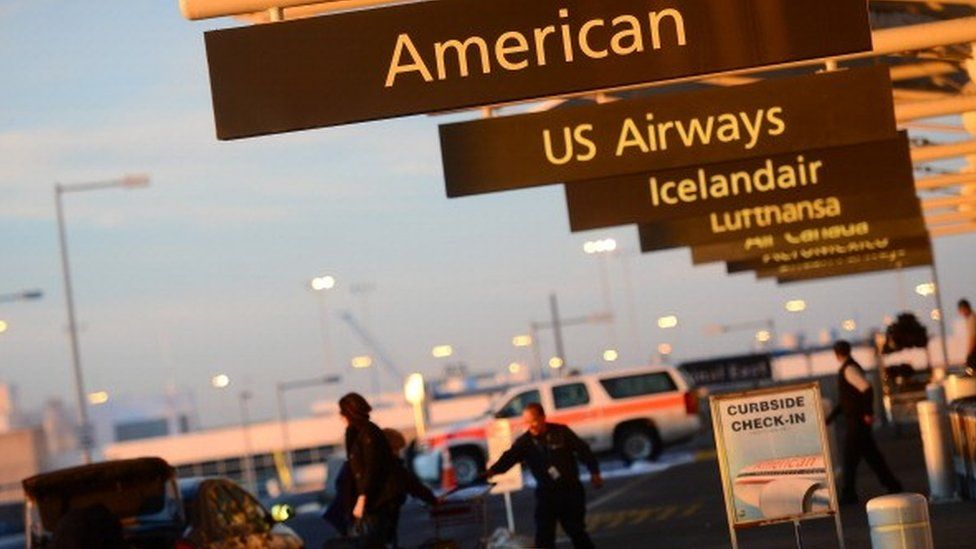 American and US Airways signs at airport
