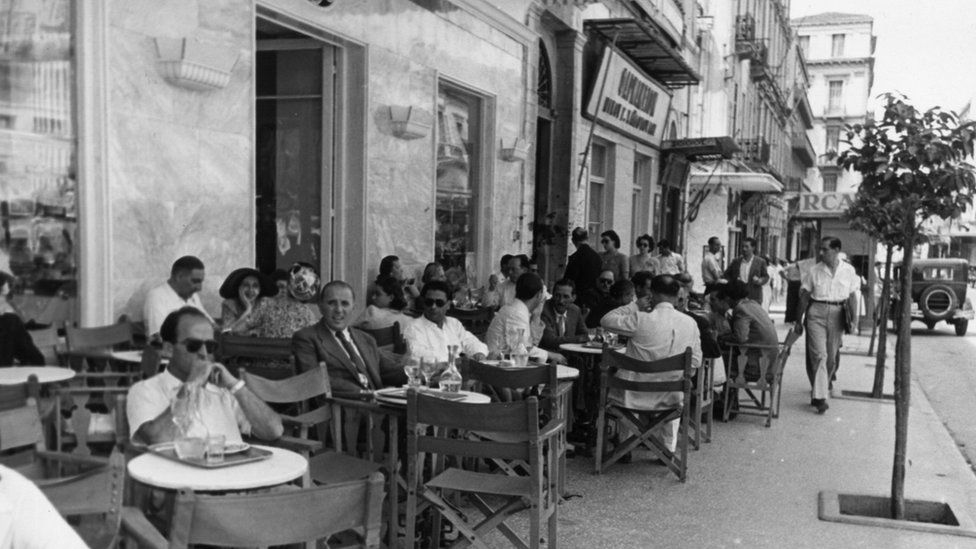 Customers enjoying the sunshine at an open air cafe in Athens, 1947