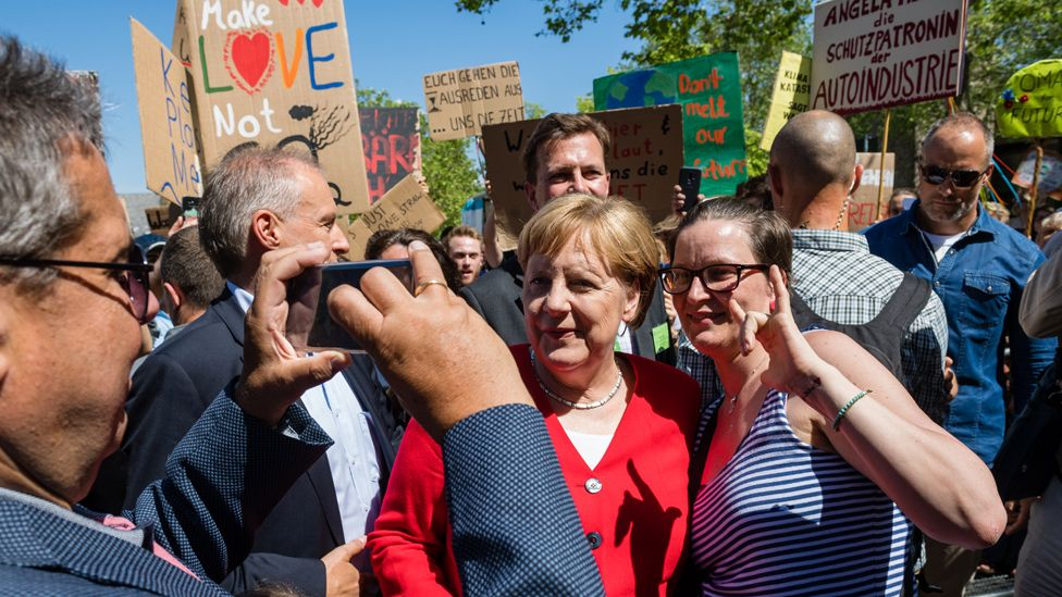 Merkel in Goslar, posing for a selfie