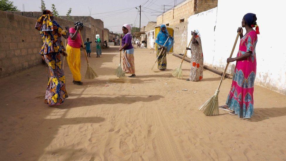 Women sweeping