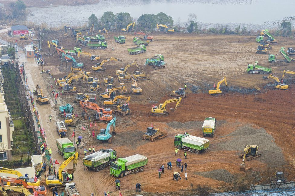 An aerial view of cranes and diggers building Huoshenshan Hospital