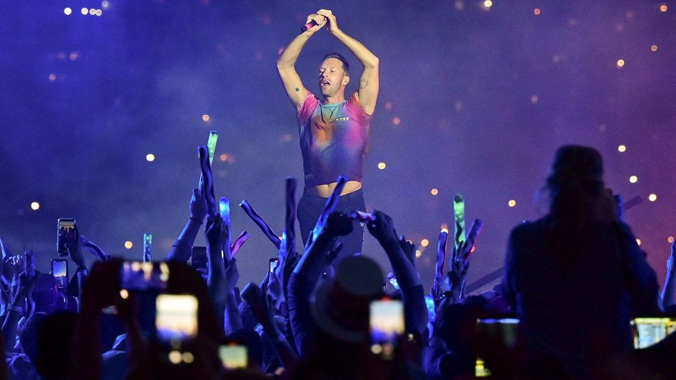 Coldplay on stage in New York in June