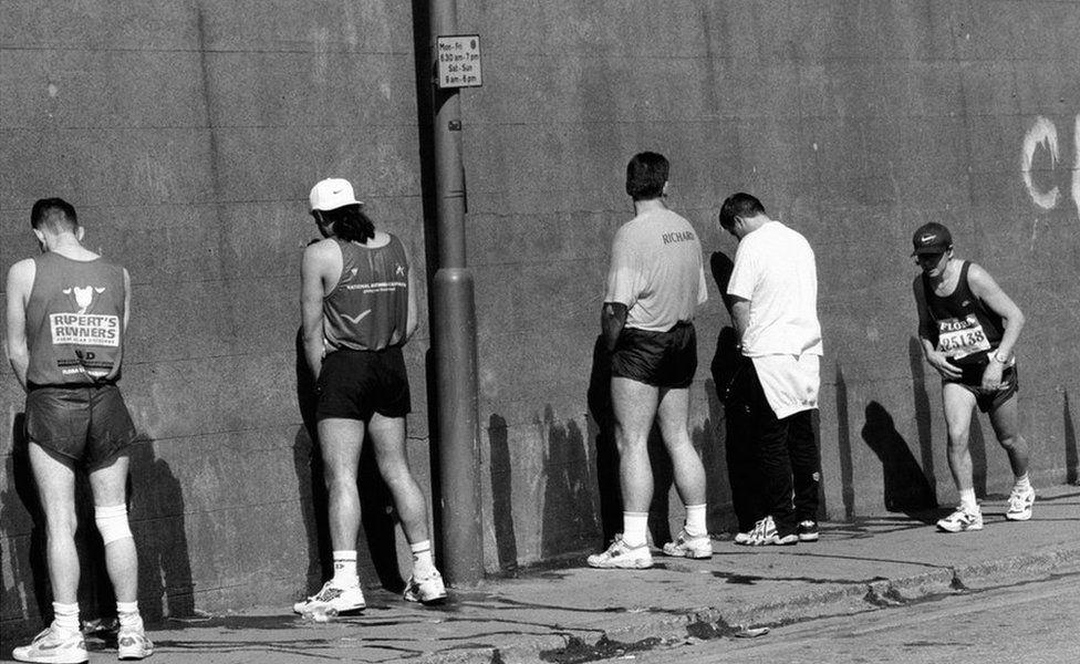 Marathon toilet queue