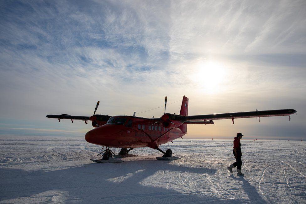 Man and plane on skis