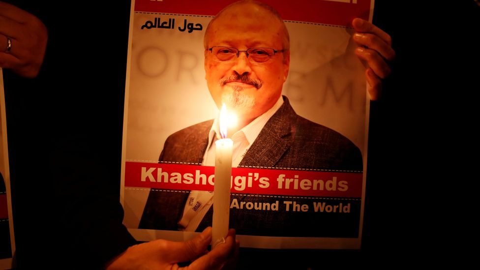 A demonstrator holds a poster with a picture of Saudi journalist Jamal Khashoggi outside the Saudi Arabia consulate in Istanbul, Turkey, in October 2018