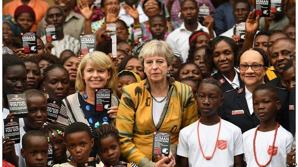 Theresa May and Foreign Office minister Harriet Baldwin meet Salvation Army workers in Lagos