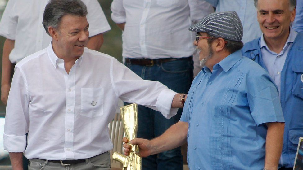 FARC rebel leader Timochenko and Colombian President Juan Manuel Santos in the disarmament ceremony