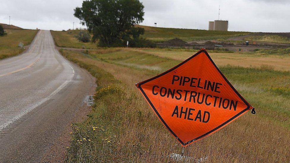 A sign warns of oil pipeline construction ahead, in Johnsons Corner, North Dakota, September 6, 2016