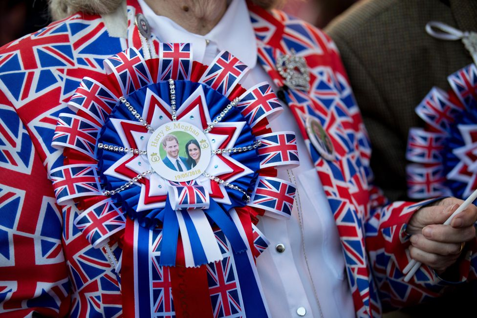 Royal fans line the streets ahead of the royal wedding ceremony of Britain's Prince Harry and Meghan Markle at St George's Chapel in Windsor Castle, in Windsor, Britain, 19 May 2018.