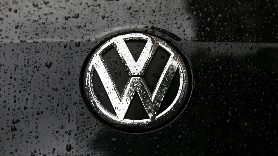Raindrops are seen on the badge of a diesel Volkswagen Passat in central London