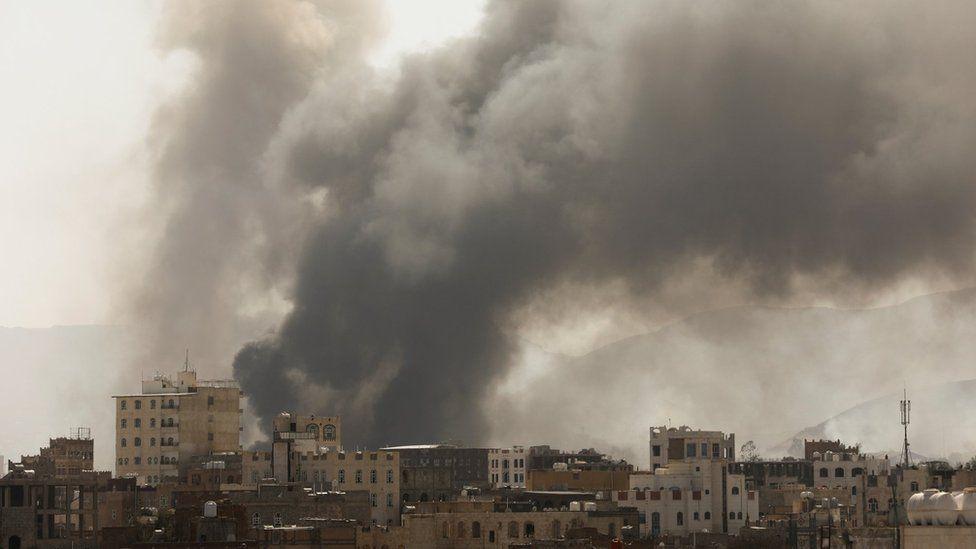 Smoke billows from the scene of Saudi-led coalition air strikes in Sanaa, Yemen (7 March 2021)