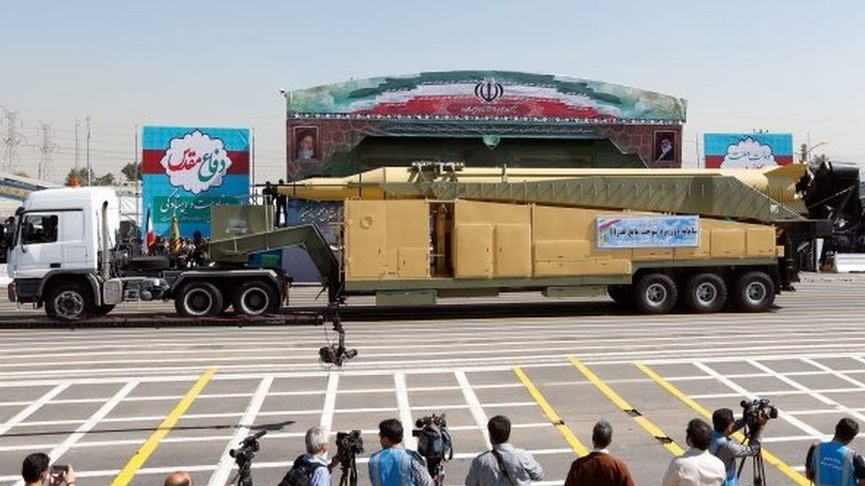 An Iranian military truck carries a long-range Ghadr-F ballistic missile during the annual military parade in Tehran (22 September 2015)