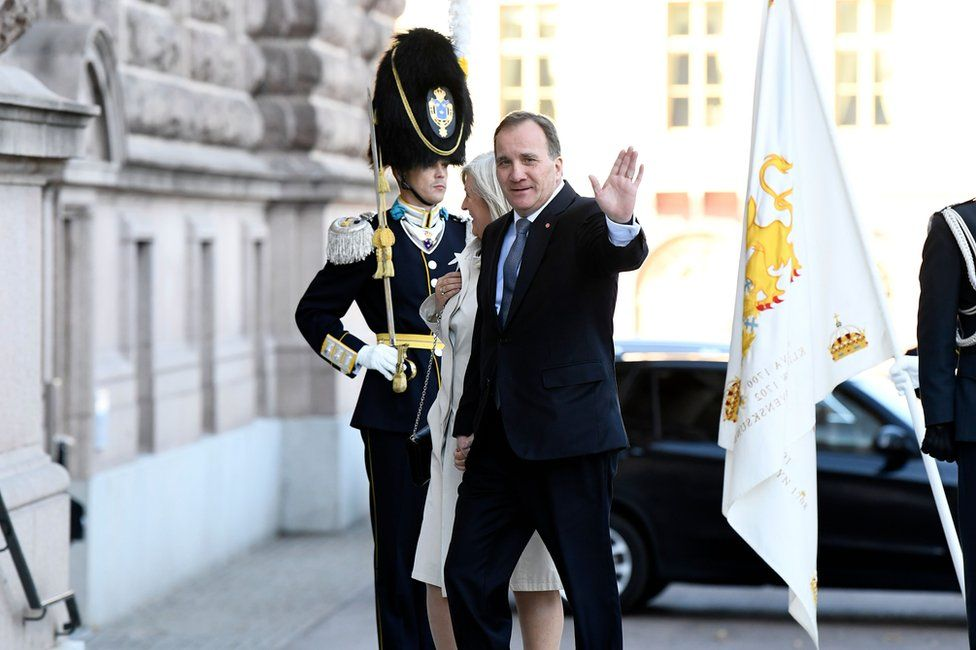 Swedish Prime Minister Stefan Lofven and his wife Ulla arrive at the Swedish parliament, 25 September