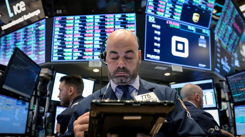 Traders work on the floor of the New York Stock Exchange (NYSE) in New York, U.S., November 7, 2018.