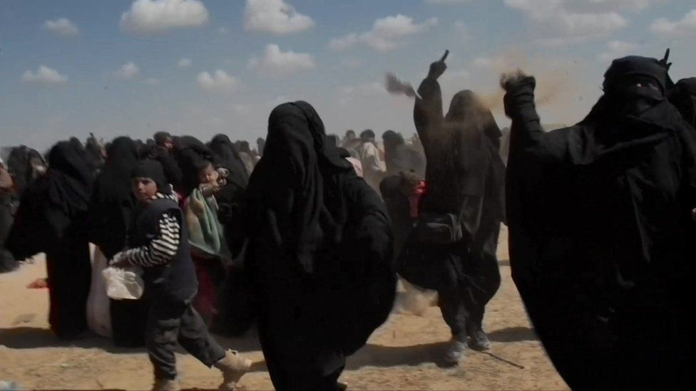 Group of IS female supporters thrown objects and dust at BBC camera