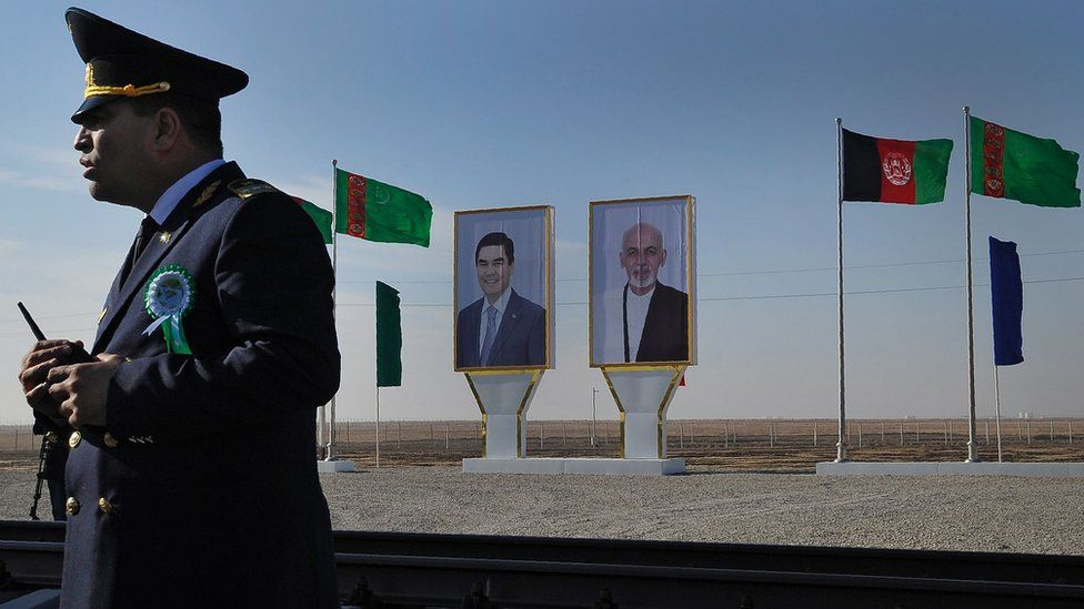 Posters with portrait of Turkmenistan's President Gurbanguly Berdymukhamedov (L) and his Afghan counterpart Ashraf Ghani are seen at Turkmenistan's Imamnazar customs point on November 28, 2016.