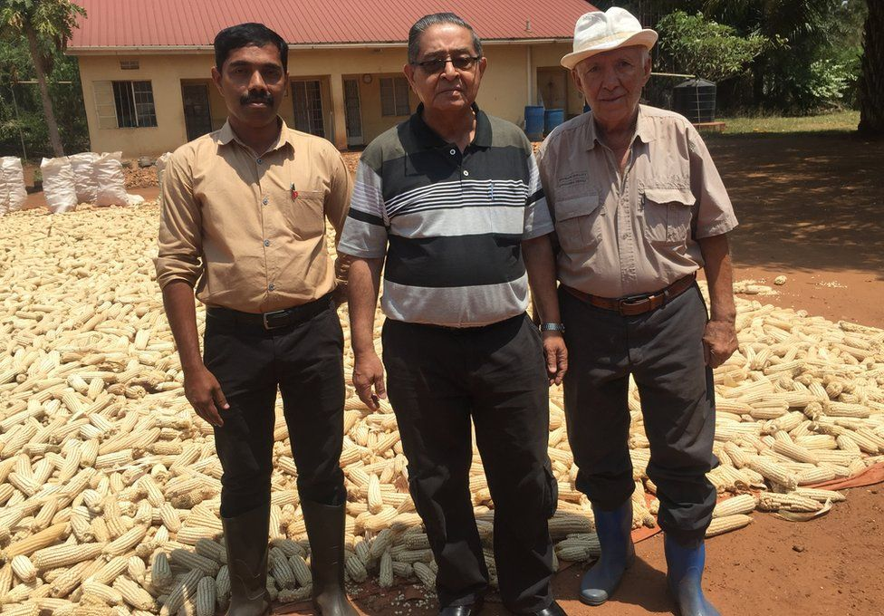Nizar Sayani pictured with two workers on his farm