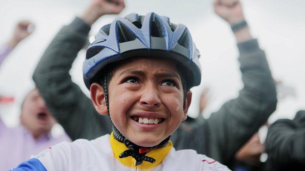 A boy cries while watching the Tour de France in Zipaquira