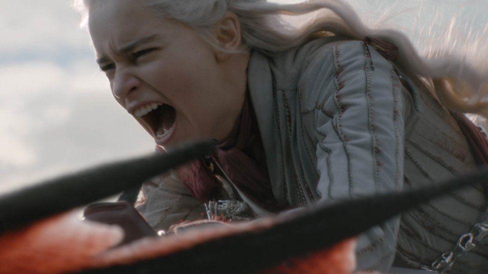 Daenerys Targaryen riding her dragon.